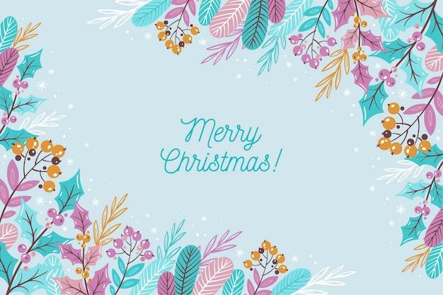 Vrolijk kerstfeest belettering op winterbehang Gratis Vector