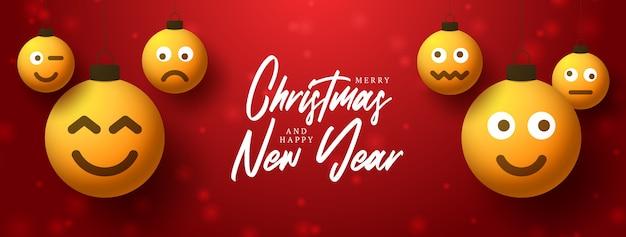 Vrolijk kerstfeest en haooy nieuwjaarsbelettering met gele emoticons op bubbelspeelgoed.