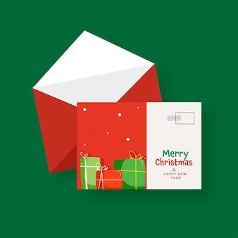 Vrolijk kerstfeest en nieuwjaarswenskaart met envelop in rode en witte kleur.