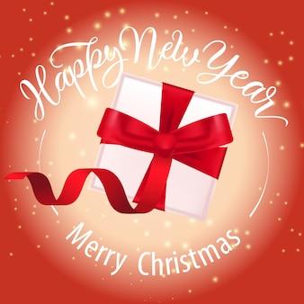 Vrolijk kerstfeest, gelukkig nieuwjaar belettering en geschenkdoos