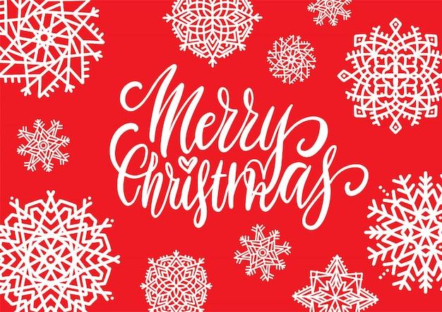 Vrolijk kerstfeest. handgeschreven elegante moderne borstel belettering met hand getrokken decoratie op rode sneeuwvlokachtergrond.