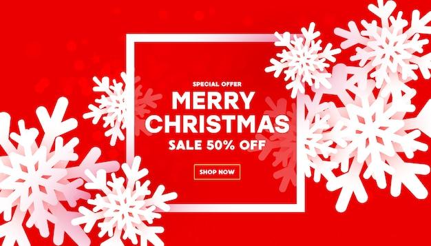 Vrolijk kerstmis en nieuwjaar met luchtige witte sneeuwvlokken en frame met tekst op een rode achtergrond met kleurovergang.