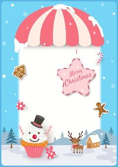 Vrolijk kerstmiskader met cupcake en koekjes aan ornamenten op blauwe achtergrond.