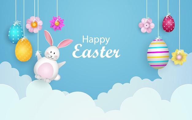 Vrolijk pasen met versierde eieren, schattig konijntje en wolken.