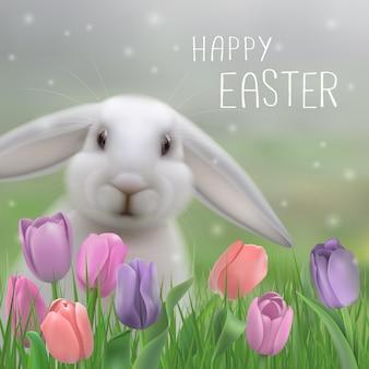 Vrolijk pasen wenskaart. eater konijn zittend in gras en delicate tulpen.