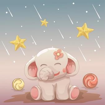 Vrolijke babyolifant die de dalende sterren bekijkt