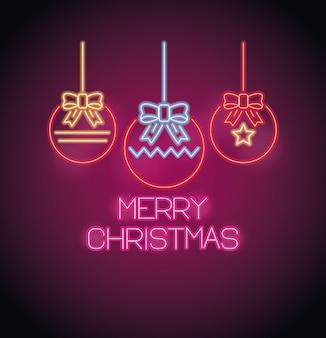 Vrolijke kerstballen opknoping met neon lichten wenskaart