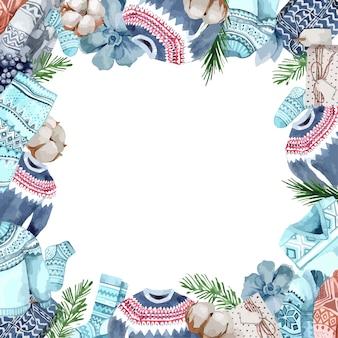 Vrolijke kerstgroet met sokken, truien, dennentakken, bessen en katoen