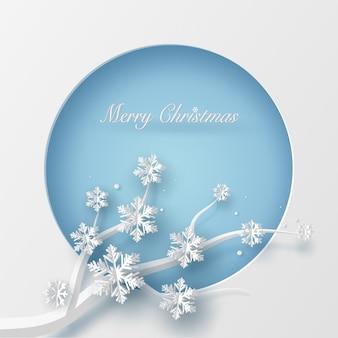 Vrolijke kerstkaart in blauwe cirkelvorm en boomtak.