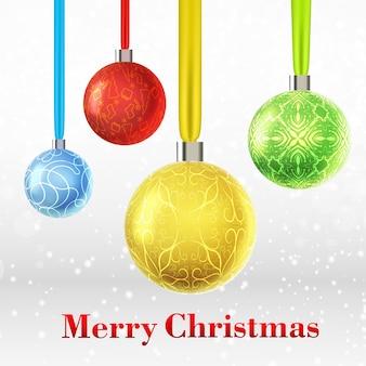 Vrolijke kerstkaart met vier kleurrijke versierde kerstballen