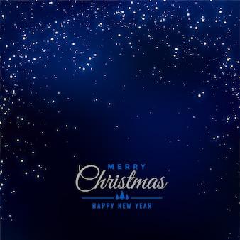 Vrolijke kerstmis blauwe achtergrond met dalende fonkelingen