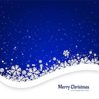 Vrolijke kerstmis blauwe achtergrond met sneeuwvlokkenontwerp