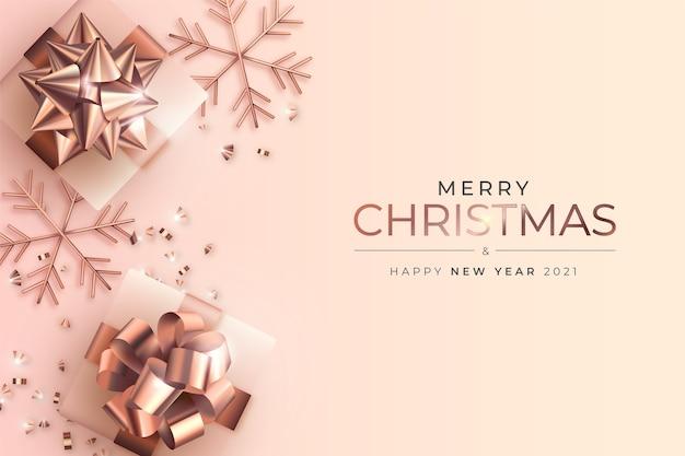 Vrolijke kerstmis en nieuwjaarskaart met realistische cadeautjes in gouden roos