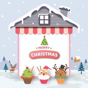 Vrolijke kerstmis met cupcakes op huisframe en sneeuwachtergrond.