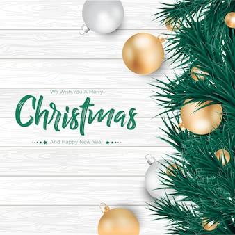 Vrolijke kerstmis met gouden en zilveren ballenachtergrond