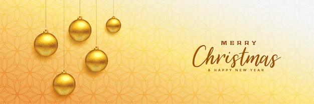 Vrolijke kerstmis mooie banner met gouden kerstmisballen