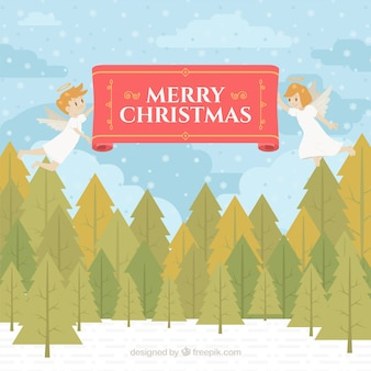 Vrolijke kerstmisachtergrond met twee engelen in een bos