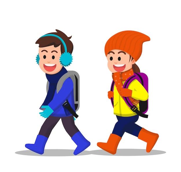 Vrolijke kinderen lopen samen naar school in de winter