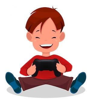 Vrolijke kleine jongen spelen van videogames