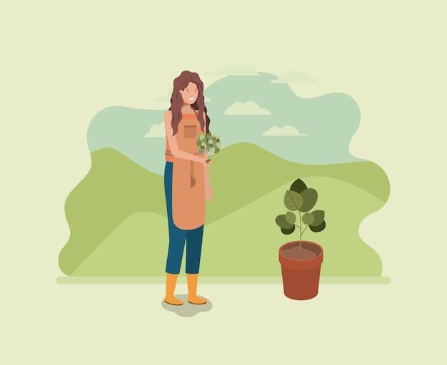 Vrouw aanplant boom in het park