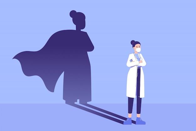 Vrouw arts die zich vol vertrouwen bevindt en superheroschaduw verschijnt achter op de muur