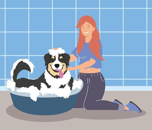 Vrouw baadt een puppy Premium Vector