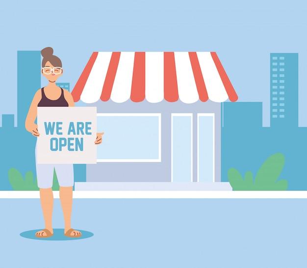 Vrouw bij zijn lokale bedrijf met open banner