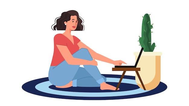 Vrouw chatten op laptop. karakter op de vloer