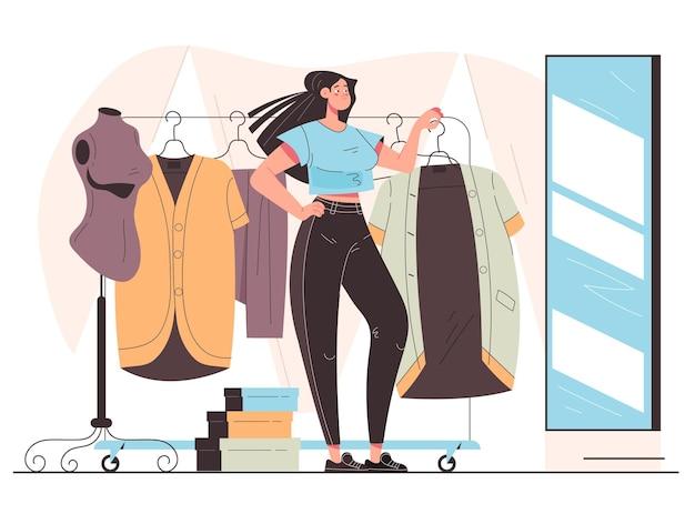 Vrouw consument karakter proberen stoffen jurk en spiegel kijken