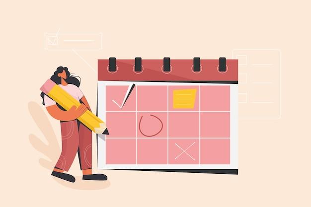 Vrouw controleert datumplannen op kalenderagenda