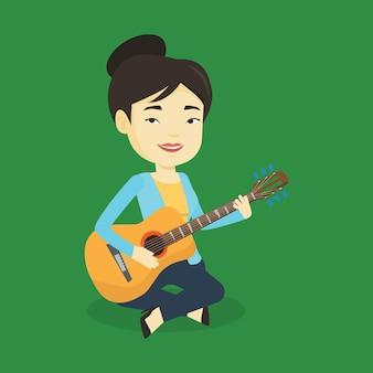 Vrouw die akoestische gitaarillustratie speelt.