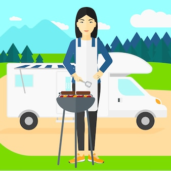 Vrouw die barbecue voorbereidt.