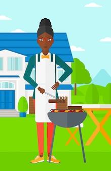 Vrouw die barbecue voorbereidt