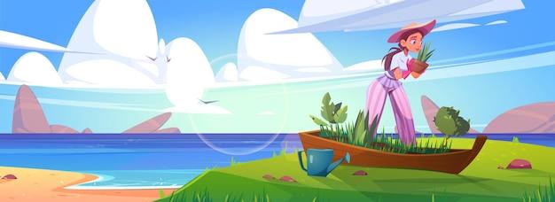 Vrouw die bloemen plant in oude boot op zeestrand