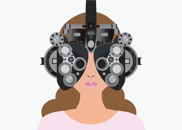 Vrouw die door phoropter tijdens oogexamen kijken