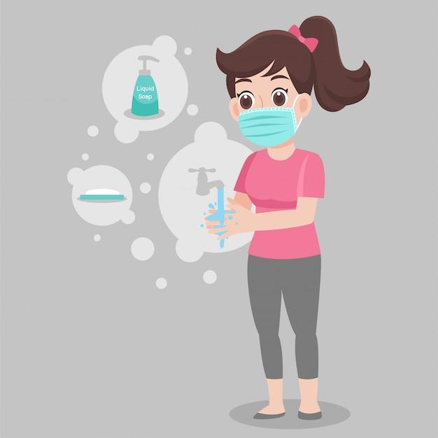 Vrouw die een chirurgische beschermende medische hand van de maskerwas met zeep draagt