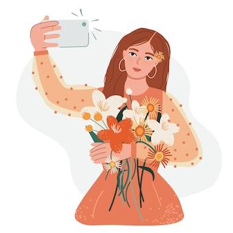 Vrouw die een foto neemt met smartphone in de handbeïnvloeding van sociale mediameisje met bloemen maakt selfie