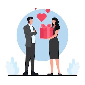 Vrouw die een geschenkdoos geeft aan de mens op valentijnsdag.