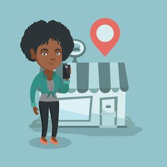 Vrouw die een restaurant in haar smartphone zoekt.