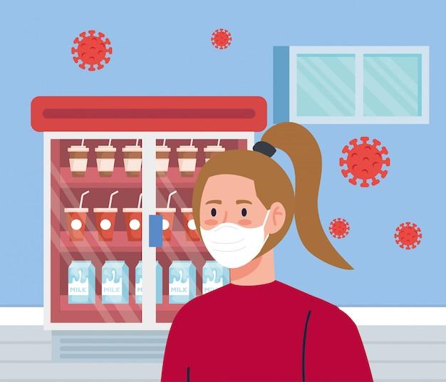 Vrouw die gezichtsmasker in supermarkt met covid deeltjes gebruiken 19