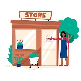 Vrouw die haar bloemenwinkel heropent