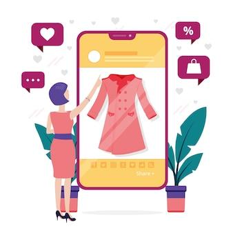 Vrouw die kleren online op mobiele telefoon bekijkt