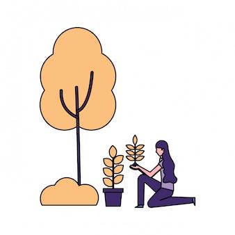 Vrouw die met installatie in pot boom plant