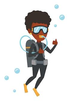 Vrouw die met scuba-uitrusting duikt en ok teken toont.