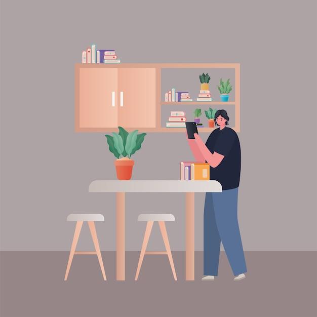Vrouw die met tablet bij keukenontwerp van het thema werk vanuit huis werkt