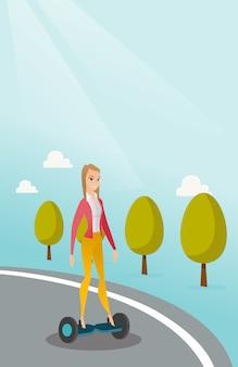 Vrouw die op zelf-in evenwicht brengt elektrische autoped berijdt
