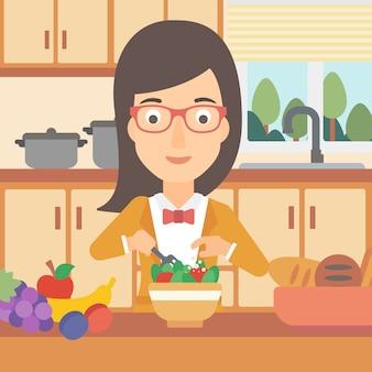 Vrouw die plantaardige salade kookt.