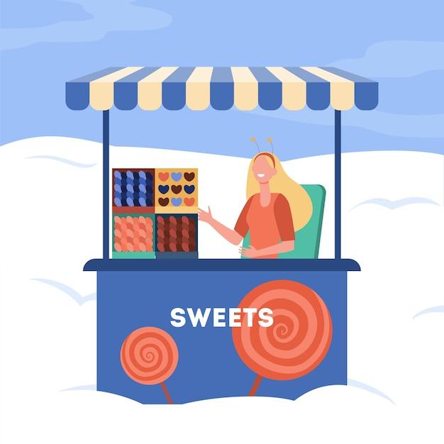 Vrouw die snoepjes van kraam verkoopt. trolley, kiosk, snoep, lollypop. cartoon afbeelding