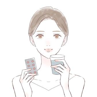 Vrouw die tablettype geneeskunde neemt. op een witte achtergrond.