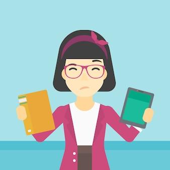 Vrouw die tussen boek en tabletcomputer kiest.